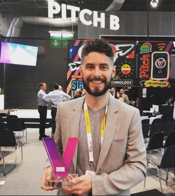Iconic CEO, John Tinsley, Accepts the VivaTech Award for an enterprise solution in the Pharma Industry.